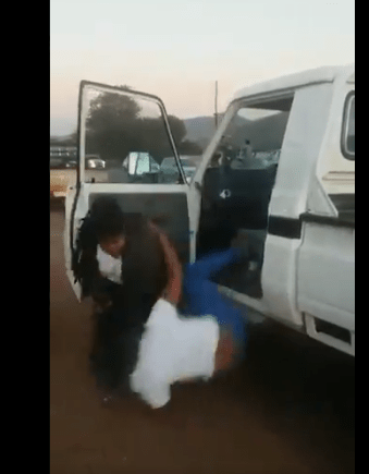 Angry Wife beats up Husband's side-chic on the street 3