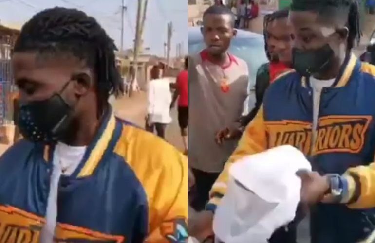 Kuami Eugene feeds kids street kids after winning VGMA Artiste of the Year